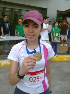 Quennie and the Elite Runner Medal